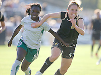 Eniola Aluko (9) and Rachel Buehler (4) battle in pursuit of the ball. St. Louis Athletica defeated FC Gold Pride 1-0 at Buck Shaw Stadium in Santa Clara, California on July 5, 2009.