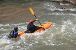 Kayaker helping swimmer at Boulder Creek, Boulder, Colorado. .  John offers private photo tours in Denver, Boulder and throughout Colorado. Year-round.