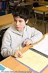 Public Middle School Grade 8 male student in class vertical