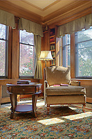 Library with over stuffed chair, bookcases and reading lamp. Dating to 1927, the Masonic Retirement Center, locally known as the Masonic Home, in Des Moines, Washington is now an elegant event center available for rental. In the historic Zenith neighborhood of the city of Des Moines. Please contact douglasorton@comcast.net regarding licensing of this image.