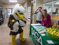 NWA Democrat-Gazette/BEN GOFF @NWABENGOFF<br /> Eddie the Eagle, Northwest Arkansas Community College mascot, tries to juggle stress balls as Josue Avelar, Student Ambassadors and Government Association secretary from Springdale, and Kat Leis, SAGA vice president from Bella Vista, look on Wednesday, Dec. 5, 2018, during the Student Ambassadors and Government Association's finals stress relief party in Burns Hall at Northwest Arkansas Community College in Bentonville. Representatives from SAGA were offering snacks, coffee, hot chocolate, stress balls, and chair massages Tuesday and Wednesday as students prepare for their final exams next week.