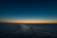 Calm ocean water at sunset.