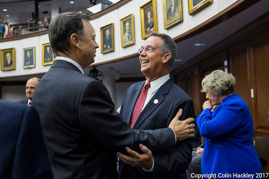TALLAHASSEE, FLA. 3/7/17-Sen. Tom Lee, R-Brandon, left, greets Chief Financial Officer Jeff Atwater during opening day of the legislative session at the Capitol in Tallahassee.<br /> <br /> COLIN HACKLEY PHOTO