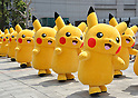 """August 10, 2016, Yokohama, Japan - 20 Pikachu characters, Nintendo's videogame software Pokemon's wellknown character, march at a shopping mall in Yokohama, suburban Tokyo on Wednesday, August 10, 2016. The Pikachu mascots walk around the shoppjng mall daily to attract summer vacationers as a part of the """"Great Pikachu Outbreak"""" event through August 14.    (Photo by Yoshio Tsunoda/AFLO) LWX -ytd-"""