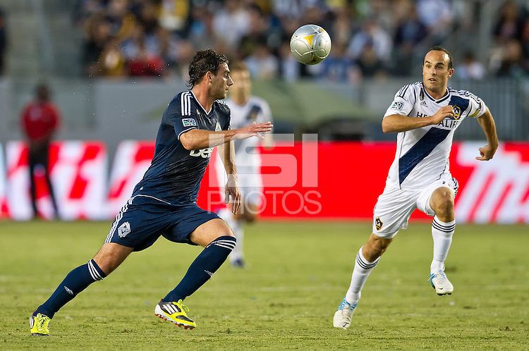 CARSON, CA - June 23, 2012: Vancouver Whitecaps defender Martin Bonjour (15) and LA Galaxy forward Landon Donovan (10) during the LA Galaxy vs Vancouver Whitecaps FC match at the Home Depot Center in Carson, California. Final score LA Galaxy 3, Vancouver Whitecaps FC 0.