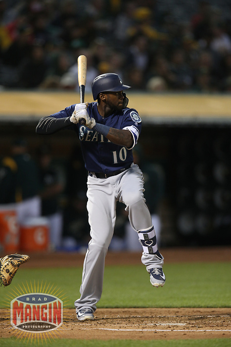 OAKLAND, CA - AUGUST 13:  Cameron Maybin #10 of the Seattle Mariners bats against the Oakland Athletics during the game at the Oakland Coliseum on Monday, August 13, 2018 in Oakland, California. (Photo by Brad Mangin)