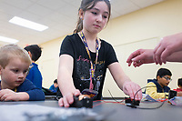 NWA Democrat-Gazette/CHARLIE KAIJO Maeve Phelps, 8, makes a circuit, Monday, November 25, 2019 during a two-day Mad Science camp at the Bentonville Community Center in Bentonville.<br /> <br /> Kids built circuits and learned how electricity flows in a two-day science camp led by a group of educators called Mad Science. They focused on how robots have a purpose and how they can determine that purpose. Their focus is to get kids excited about science through hands on activities. They partnered with the Bentonville Community Center to hold camps since the summer of 2018.