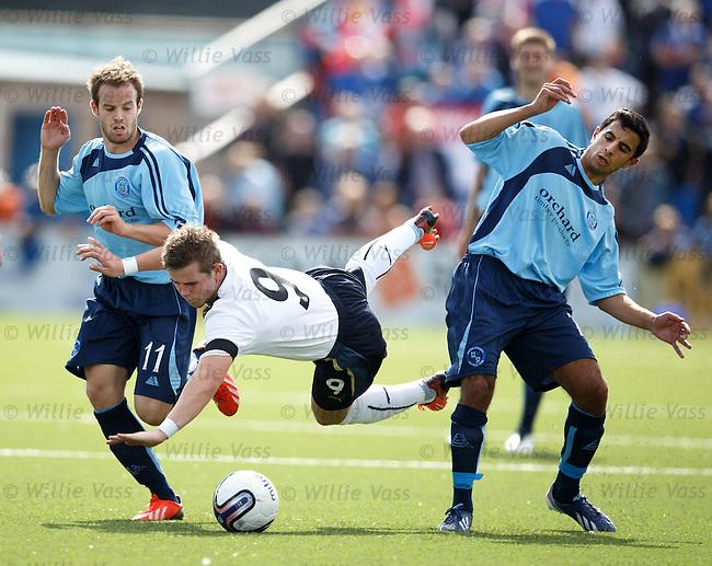 David Templeton fouled by Gavin Malin and Omar Kader