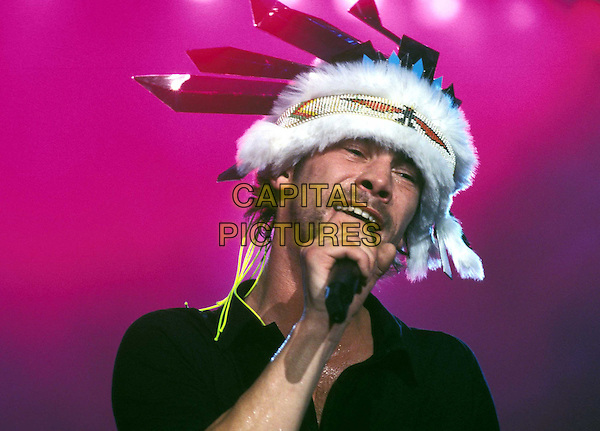JAMIROQUAI.In concert at Wembly Arena  .Ref: 11514.micropone, feathers, singing, live, stage, indian, Jay Kay, headshot, portrait.www.capitalpictures.com.sales@capitalpictures.com.© Capital Pictures