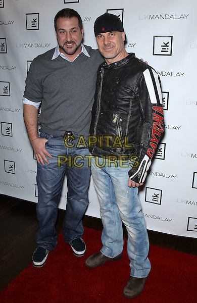Joey Fatone, Peter Lik.Grand opening of the new Peter Lik gallery, Lik Mandalay, at The Shoppes at  Mandalay Place, Las Vegas, Nevada, USA, 25th February 2012..full length  grey gray jumper jeans black leather jacket hat .CAP/ADM/MJT.© MJT/AdMedia/Capital Pictures.