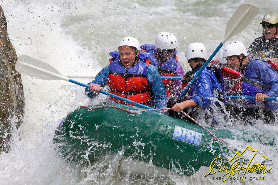 Whitewater Rafters dropping into house Rock Rapid on the Gallatin River in southewest Montana.