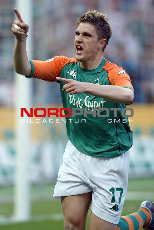DFB - Pokalfinale Berlin<br /> <br /> Alemania Aachen vs Werder Bremen<br /> <br /> Der Bremer Ivan Klasnic jubelt Łber sein Tor zum 2:0.<br /> <br /> Foto &copy; nordphoto <br /> <br /> <br /> <br />  *** Local Caption *** Foto ist honorarpflichtig! zzgl. gesetzl. MwSt.<br /> <br />  Belegexemplar erforderlich<br /> <br /> Adresse: nordphoto<br /> <br /> Georg-Reinke-Strasse 1<br /> <br /> 49377 Vechta