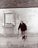 FRANCE, Burgundy (B&W), senior man standing with a pet dog, Chablis