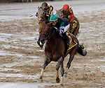 Diversify (no. 6) wins the Whitney Stakes (Grade I), Aug. 4,2018 at the Saratoga Race Course, Saratoga Springs, NY.  Ridden by Irad Ortiz, Jr., and trained by R. A. Violette Jr.,  Diversity won handily  on a sloppy track and finished in front of Mind Your Biscuits (no. 4).  (Photo credit: Bruce Dudek/Eclipse Sportswire)