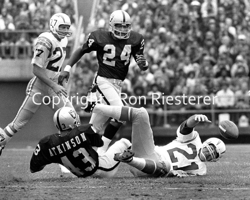 San Diego QB John Hadl fumbles ball, Raiders Willie Brown and george Atkinson. (1972 photo/Ron Riesterer)