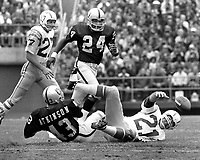 San Diego QB John Hadl fumbles ball, Raiders Willie Brown and george Atkinson. (1972 photo/Ron Riesterer)