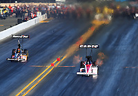 Jul. 26, 2014; Sonoma, CA, USA; NHRA top fuel driver Steve Torrence (right) races alongside Clay Millican during qualifying for the Sonoma Nationals at Sonoma Raceway. Mandatory Credit: Mark J. Rebilas-