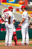 Kevin Thomas (35) of the Springfield Cardinals talks with Charles Cutler (37) and Pitching Coach Bryan Eversgerd (34) on the mound during a game against the Midland RockHounds on April 19, 2011 at Hammons Field in Springfield, Missouri.  Photo By David Welker/Four Seam Images