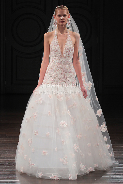 Model walks runway in an Amafi bridal gown from the Naeem Khan Bridal Spring 2017 collection at 260 West 36 Street, during New York Bridal Fashion Week Spring Summer 2017 on April 16, 2016.