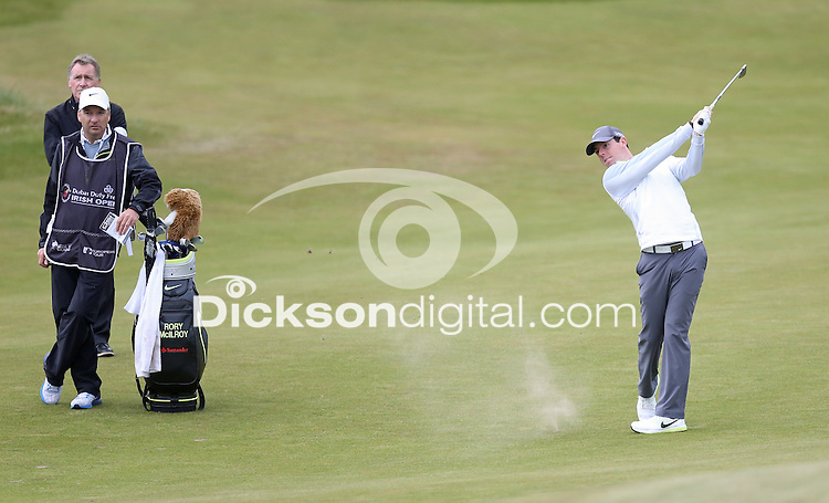 27 May 2015; Rory McIlroy plays his approach to the 3rd green watched by his caddie J.P. Fitzgerald and coach Michael Bannon.<br /> <br /> Dubai Duty Free Irish Open Golf Championship 2015, Pro-Am. Royal County Down Golf Club, Co. Down. Picture credit: John Dickson / DICKSONDIGITAL