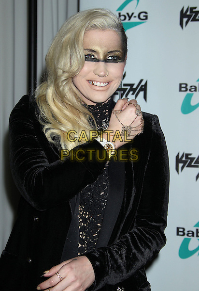 Ke$ha, Kesha, Kesha Rose Sebert.Ke$ha unveils her new 'Baby G' watch line design at SLS Hotel, Beverly Hills, California, USA..October 29th, 2012.half length hand black top jacket gold make-up eyes white watch wristwatch bracelet tooth .CAP/ADM/RE.©Russ Elliot/AdMedia/Capital Pictures.