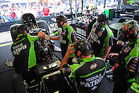Apr. 29, 2012; Baytown, TX, USA: NHRA crew members for funny car driver Alexis DeJoria during the Spring Nationals at Royal Purple Raceway. Mandatory Credit: Mark J. Rebilas-