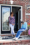 "Karen Morris has been caring for her mother Gloria, 80, for the past 10 years. Her mother has Alzheimer's disease and lives with Karen and Karen's husband Richard in their Charlotte, NC home. The pair take in the morning on the front porch...Mrs. Morris was a nurse before she retired and really enjoys taking care of people, she said. Every morning she washes her mother in the bathroom, helps her walk down the stairs, and they share breakfast, as they did Monday, October 18, 2010...Gloria was having an especially bad day and because Karen sees her every day, she knew something was wrong. She later discovered her medication was dehydrating her. That is one of many reasons why having a regular caretaker is so important. ..Released: Yes.""Caretaker"".Assignment c/o Ilene Bellovin"