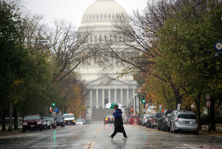 UNITED STATES - OCTOBER 29:  A pedestrian crosses East Capitol Street on Monday, when the federal government was shut down as Hurricane Sandy passed over the region.  (Photo By Tom Williams/CQ Roll Call)