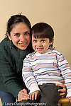 portrait headshot of preschool boy age 3 with his mother vertical
