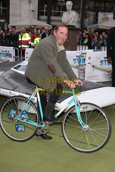"PETE POSTLETHWAITE.UK Premiere of ""The Age of Stupid"" held in a Solar Powered Tent in Leicester Square, London, England..March 15th, 2009.full length black trousers brown cardigan jacket elbow patches bike bicycle riding .CAP/ROS.©Steve Ross/Capital Pictures"