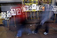 Uruguayans pass in front of posters of people who disappeared between 1973-1985 during Uruguay's military dictatorship, at a protest in Montevideo, Uruguay, Friday, Sept. 30, 2005.  The Uruguayan government is trying to find the fate of the remains of those who disappeared during the dictatorship. .Photo/Marcelo Hernandez