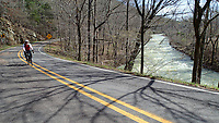 NWA Democrat-Gazette/FLIP PUTTHOFF <br /> Arkansas 215 is the Mulberry River Road Scenic Byway. The route runs east along the river from Arkansas 23 to Oark and Catalpa. Tom Mowry rides March 26 2017 near the river.