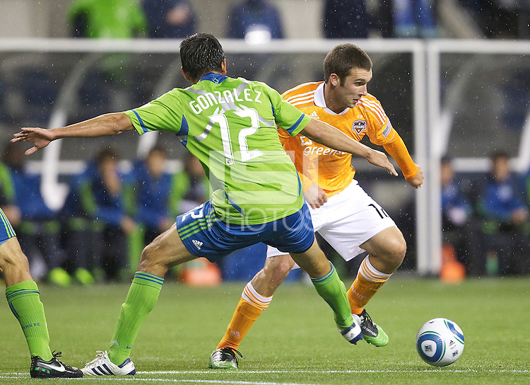 Houston Dynamo forward Will Bruin, right, tries to get around Seattle Sounders FC defender Leonardo Gonzalez  during play at Qwest Field in Seattle Friday March 25, 2011. The match ended in a 1-1 draw.