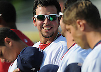 Veteran Major Leaguer Chris Marrero (19) of Washington Nationals smiles at a teammate during the National Anthem before a rehab assignment with the Class A Potomac Nationals in a game against the Salem Red Sox on June 8, 2012, at Pfitzner Stadium in Woodbridge, Virginia. Potomac won, 5-4. (Tom Priddy/Four Seam Images)