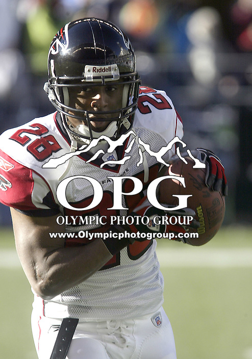 Atlanta Falcons running back Warrick Dunn warms up before the start of the game against the Seattle Seahawks at Quest field in Seattle, WA.