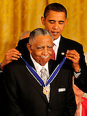Washington, DC - August 12, 2009 -- United States President Barack Obama (R) presents civil rights leader Rev. Joseph Lowry the 2009 Medal of Freedom, America's highest civilian award, in the East Room of the White House in Washington, DC, USA August 12, 2009.    .Credit: Mike Theiler / CNP