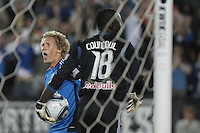 San Jose Earthquakes forward Steven Lenhart (24) celebrates after scoring a goal against New York Red Bulls goalkeeper Bouna Coundoul (18). The San Jose Earthquakes tied the New York Red Bulls 2-2 at Stanford Stadium in Stanford, California on July 2nd, 2011.