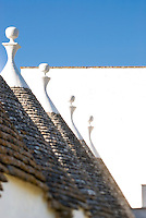 A 'trullo' is a typical Apulian rural building characterised by a cone-shaped roof