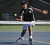 Avi Anand of Half Hollow Hills East returns a volley from Rahul Mathur of Hills West (not in picture) in the third singles match of the Suffolk County varsity boys tennis team championship at Half Hollow Hills High School East on Wednesday, May 17, 2017. Anand won the match for Hills East 6-4, 6-2.