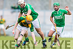 Robert Collins Kilmoyley in action against Garry O'Brien and Mikey Boyle Ballyduff in the County Senior Hurling Final at Austin Stack Park on Sunday.