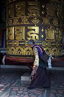 Huge Prayer Wheel at the Kopan Monastery of Tibetan origin in Kathmandu Nepal