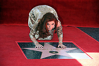 05 October 2017 - Hollywood, California - Debra Messing. Debra Messing Honored With Star On The Hollywood Walk Of Fame. <br /> CAP/ADM/FS<br /> &copy;FS/ADM/Capital Pictures