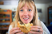 Christine Marozick enjoys a venison pie along the Haast Highway, West Coast, New Zealand.