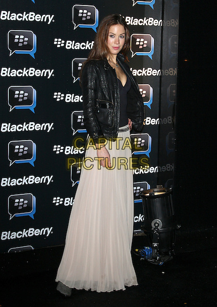 Roxanne McKee.Blackberry BBM Party, Bankside Vaults, London, England..April 3rd 2012.full length black leather jacket white skirt sheer top .CAP/ROS.©Steve Ross/Capital Pictures.