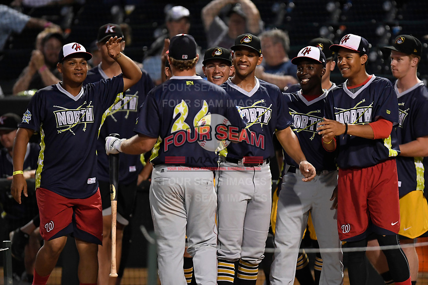 Sheldon Neuse of the Hagerstown Suns is congratulated by teammates in the Home Run Derby as part of of the South Atlantic League All-Star Game festivities on Monday, June 19, 2017, at Spirit Communications Park in Columbia, South Carolina. (Tom Priddy/Four Seam Images)