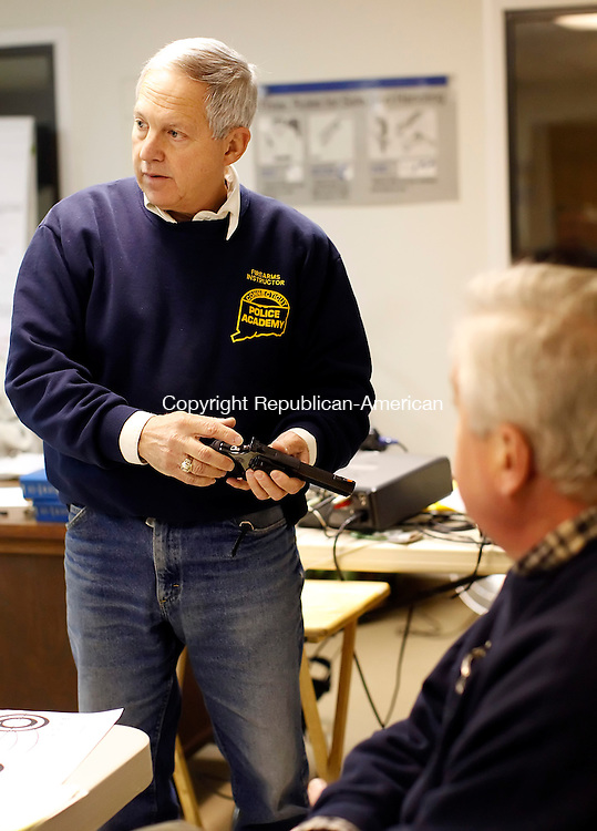 New Milford, CT- 24 January 2013-012413CM02-  Herbert G. Furham, a certified firearms instructor goes over the components of a firearm during a pistol permit class Thursday afternoon in New Milford.   Christopher Massa Republican-American