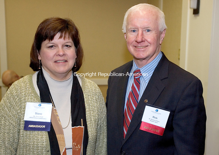 WATERBURY, CT. 27 January 2010-012710SV13--From left, Diane Ploch, Arts and Culture Collaborative, and Richard O'Brien of Webster Bank attend the Legislative Breakfast sponsored by The Waterbury Regional Chamber Public Policy Committee held at the Courtyard by Marriott in Waterbury Wednesday.<br /> Steven Valenti Republican-American