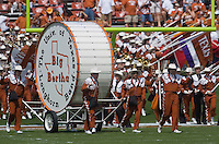 "23 September 2006: Members of the Texas Longhorn band lead ""Big Bertha"" onto the field during the pre-game show before the Longhorns game against the Iowa State Cyclones at Darrell K Royal Memorial Stadium in Austin, TX."