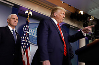 United States President Donald J. Trump speaks during a press briefing on the Coronavirus COVID-19 pandemic with members of the Coronavirus Task Force at the White House in Washington on March 19, 2020.   At left is US Vice President Mike Pence.<br /> Credit: Yuri Gripas / Pool via CNP/AdMedia