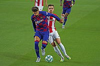 23rd June 2020, Camp Nou, Barcelona, Spain; La Liga Football league, FC Barcelona versus Athletico Bilbao;  Gerard Pique holds off the challenge